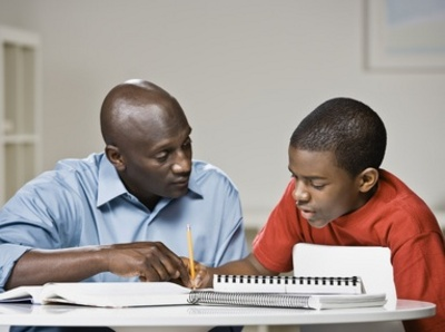 African father helping son with homework