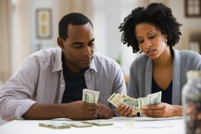 Couple counting money --- Image by © Jose Luis Pelaez Inc/Blend Image/Blend Images/Corbis